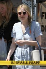 Dakota Fanning Is seen in a long blue denim dress on a sunny Sunday at the farmers market with friends in Studio City