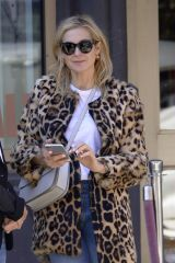Kelly Rutherford Seen wearing a leopard fur coat and denim pants after having lunch at Cipriani's SOHO in New York