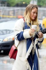 Hilary Duff Seen getting a cup of coffee on a rainy day in NYC