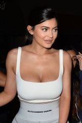 Kylie Jenner Showing off her curves in some tight-fitting athletic wear during a night out at a restaurant in LA