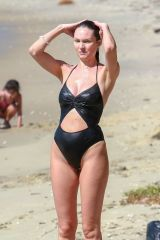 Candice Swanepoel At the beach in a revealing one piece swimsuit in Victoria, Brazil