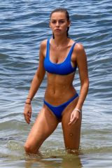 Elizabeth Turner Enjoys a day at the beach in Miami with her friend