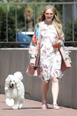 Kathryn Newton Strolls with her dog in Beverly Hills