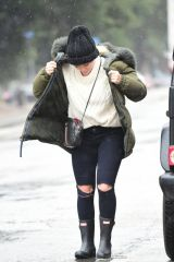 Hilary Duff Goes out in the rain in Los Angeles