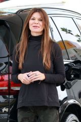 Danielle Vasinova Fills up her car at the gas station in Studio City
