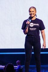 Olivia Holt Speaks on stage during WE Day at Tacoma Dome in Tacoma