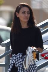 Mila Kunis Cuts a casual figure while exiting a nail spa In Studio city