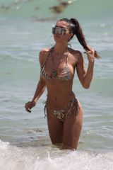 Metisha Schaefer In an animal print bikini as she hits the beach in Miami