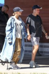 Justin Bieber & wife Hailey Baldwin hold hands while departing Boston