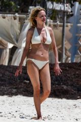 Heather Graham Sizzles out in Tulum as she enjoys her vacation in a stunning white two piece bikini
