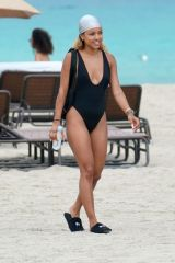 Karrueche Tran In a black one piece swimsuit at the beach in Miami Beach