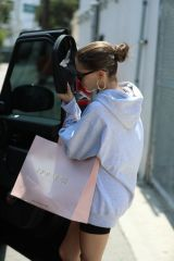 Madison Beer Acts camera shy while leaving House of CB clothing store in West Hollywood