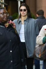 Kendall Jenner Keeps it simple yet stylish in a work jacket and oval sunglasses