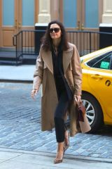 Katie Holmes Hints a smile as she arrives at the Crosby Hotel in New York City