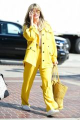 Heidi Klum Rocks head to toe yellow at America's Got Talent Finals