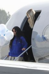Kim, Kourtney, and Khloe Kardashian depart from Van Nuys Airport