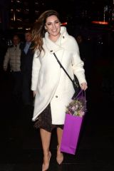 Kelly Brook Braves the wind as she is seen leaving Global Radio studios in London