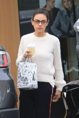 Mila Kunis Makes a run at Alfred's Coffee in West Hollywood