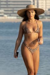 Francesca Allen Enjoying a stroll on the beach while on holiday in Dubai