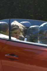 Heidi Klum and Tom Kaulitz in their Bentleyt convertible
