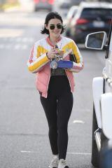 Lucy Hale Flashes a smiles while on a coffee run after a workout in Los Angeles