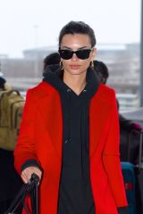 Emily Ratajkowski Beams in red for flight at JFK airport