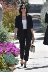 Lucy Hale All dressed up leaving Aroma cafe in Studio City