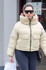 Kelly Brook Keeps bundled up from the cold while out shopping in London