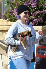 Kelly Osbourne Cradles her dog in her arms while out grabbing take out from popular Kristy's in Malibu