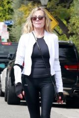 Melanie Griffith Wears fingerless gloves for her walk