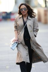 Myleene Klass Wears trench coat and black buckled jumpsuit arrives Smooth Radio in London