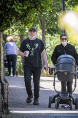 Rupert Grint & Georgia Groome Seen with their newborn daughter for the first time as they steps out for a summer stroll in London