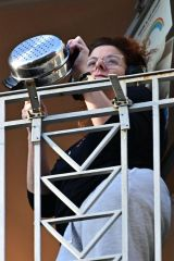 Debra Messing Cheering on first responders from her balcony in New York