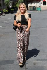 Sian Welby Wears crop top and snakeskin print trousers