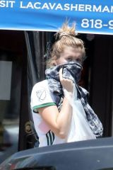 Ireland Baldwin In shorts grocery shopping in LA