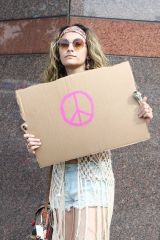 Paris Jackson Holds a sign showing her support as she attends a protest in Los Angeles