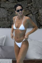 Izabel Goulart In white bikini white poolside in Mykonos