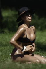 Arianna Ajtar In black bikini as she enjoys an afternoon in a park in Manchester City Centre