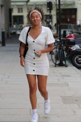 Yasmin Evans In white minidress while leaving BBC radio studios