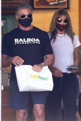 Sylvester Stallone and his wife Jennifer Flavin hold hands as they take a walk to a Subway in Malibu