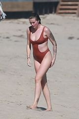Ireland Baldwin In a red one piece swimsuit while out enjoying a beach day with her friends in Malibu