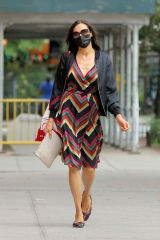 Famke Janssen Walks home in a colorful dress in Soho in New York