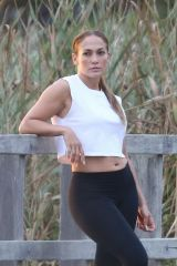 Jennifer Lopez Posing for Sunset Portraits on a Bike ride in Hamptons