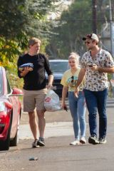 Ariel Winter And boyfriend Luke Benward greet a family member outside their home in Studio City