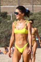 Camila Coelho In yellow bikini while enjoying a beach day with Alessandra Ambrosio