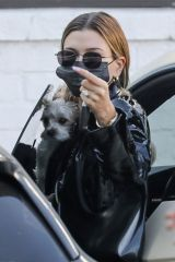 Hailey Bieber Stops by a studio with her dog ahead of a photoshoot in Los Angeles