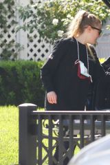 Dakota Fanning Taking Miller high life beer from her car in LA