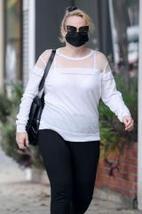 Rebel Wilson Feeds her parking meter as she arrives at a skincare salon in Beverly Hills