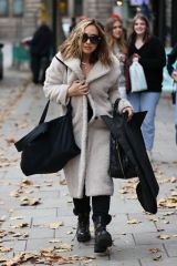 Myleene Klass Wraps up in wool coat at Smooth radio in London