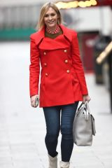 Jenni Falconer Wears striking read coat and skinny denim jeans at the Heart Radio Studios in London